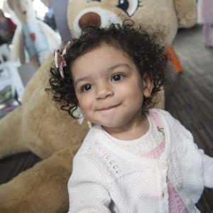 One-year-old Azariah with teddy bear