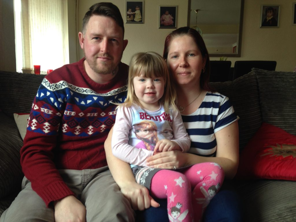 Brooke, now three, with her mum and dad.